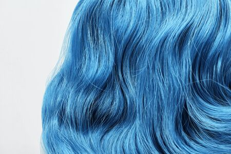 Close up view of blue colored hair isolated on white