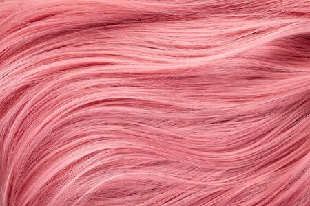 Close up view of colored pink hair