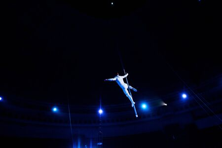 back view of acrobat performing in arena of circus