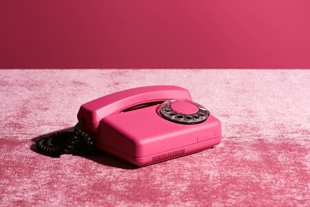 vintage phone on velour pink cloth isolated on pink, girlish concept Imagens