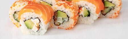 delicious Philadelphia and California sushi with salmon and masago caviar on white background, panoramic shot 版權商用圖片