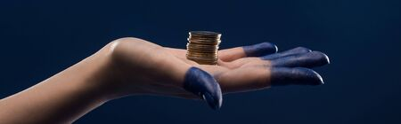 cropped view of female hand with painted fingers holding coins isolated on blue, panoramic shot