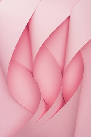 top view of pink paper swirls on pink background 写真素材
