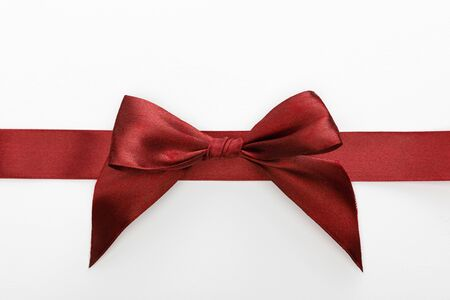top view of satin burgundy decorative ribbon with bow isolated on white Reklamní fotografie