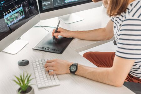 cropped view of editor typing on computer keyboard
