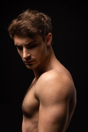 man with muscular torso isolated on black Stock Photo