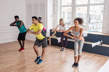 Multicultural dancers training together in dance studio