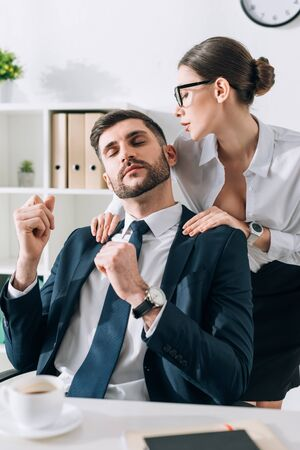 sexy secretary with big breast doing massage to businessman in office