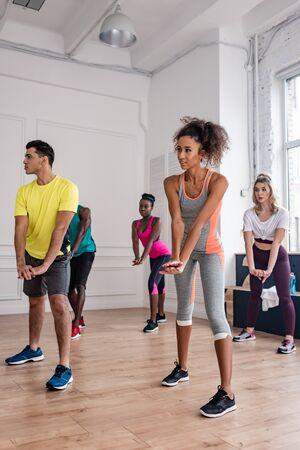 Young multiethnic dancers performing in dance studio
