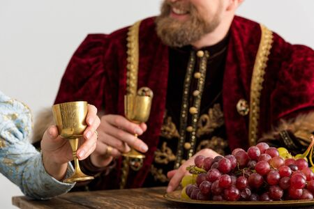 selective focus of grape and queen with king on background isolated on grey Stock Photo
