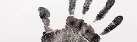 panoramic shot of black print of hand isolated on white, human rights concept Stock Photo