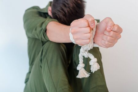 selective focus of man with tied hands isolated on white 免版税图像