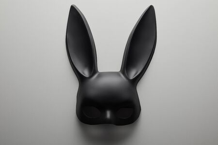 top view of black rabbit mask on white background