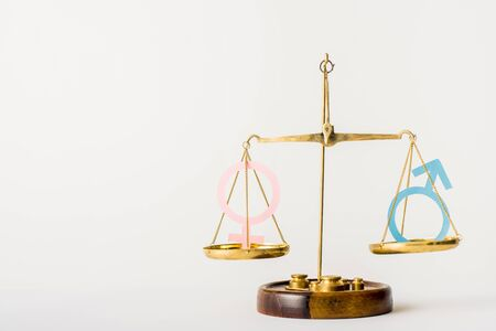 golden justice scale with different genders isolated on white, equality concept Foto de archivo