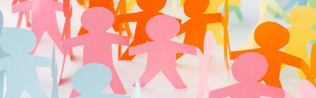 panoramic shot of colorful paper cut chain people on white, human rights concept