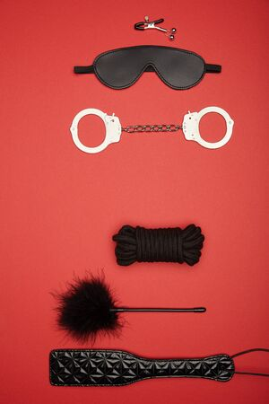 top view of black toys isolated on red