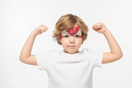 adorable boy with spiderman mask painted on face demonstrating power isolated on white