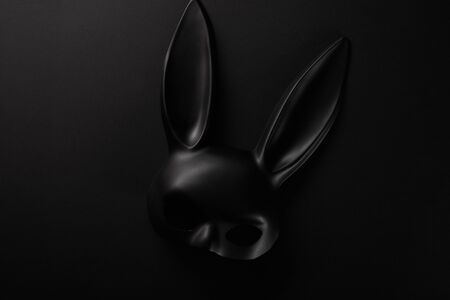 top view of rabbit black mask isolated on black
