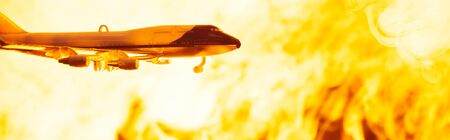Battle scene with toy plane with fire at background, panoramic shot