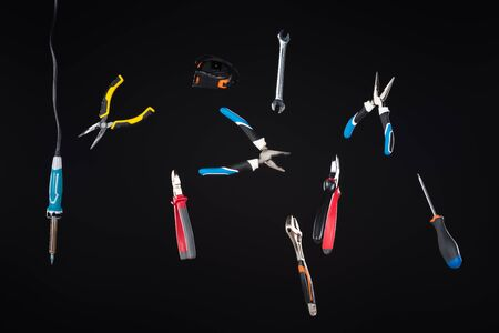 Set of tools levitating in air isolated on black
