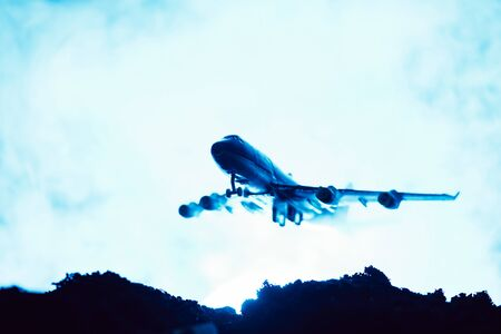 Battle scene with toy plane with smoke on blue background