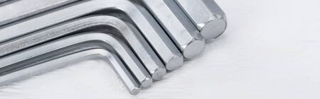 Close up view of hex keys on white wooden background, panoramic shot 写真素材