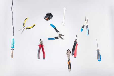 Set of tools levitating in air isolated on grey