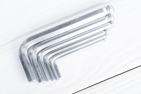 Top view of hex keys on white wooden background 写真素材