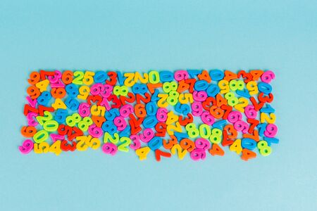 Top view of plastic colorful numbers on blue background Stock fotó