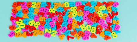 Top view of colorful numbers on blue background, panoramic shot Stock fotó