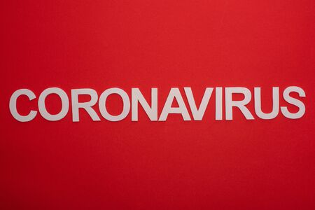 Top view of coronavirus inscription isolated on red Stock Photo