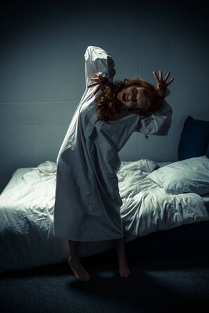 creepy girl in nightgown shouting in bedroom