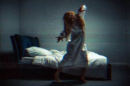 selective focus of obsessed creepy girl in nightgown shouting in bedroom