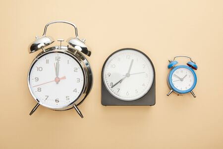 top view of clocks on blue background
