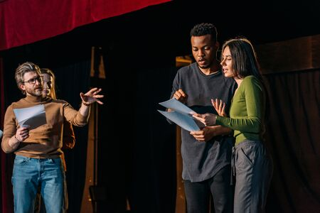 theater director, multicultural actors and actress rehearsing on stage Stock fotó