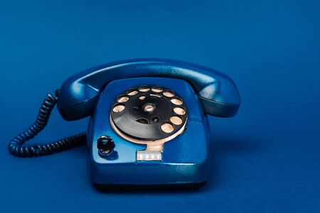 bright and colorful retro telephone on blue background Stockfoto