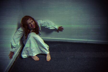 obsessed demonic girl in nightgown yelling near wall
