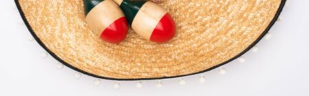 Top view of sombrero and maracas on white background, panoramic shot