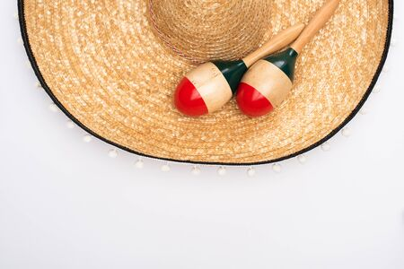 Top view of maracas with sombrero on white background 写真素材