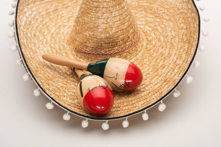 Close up view of maracas on sombrero on white background 写真素材