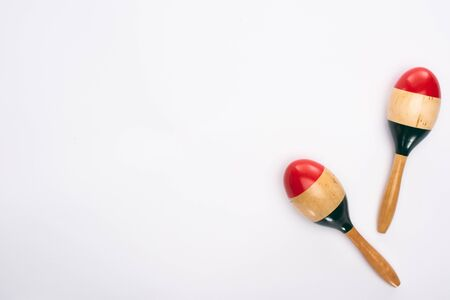 Top view of wooden colorful maracas on white background 写真素材