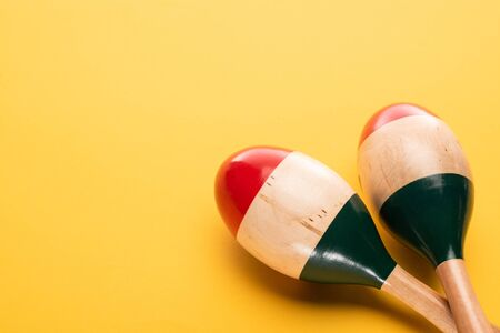Close up view of wooden maracas on yellow background 写真素材