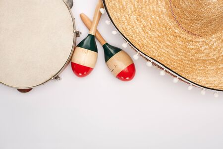 Top view of wooden maracas with tambourine and sombrero on white background 写真素材