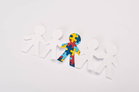 High angle view of special kid with autism among another on white background