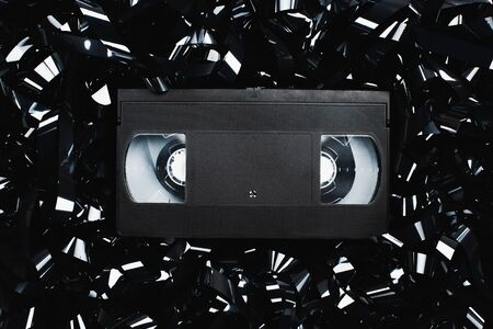 top view of black VHS cassette on film strip