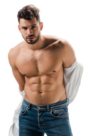 seductive muscular man in white shirt and jeans isolated on white Zdjęcie Seryjne