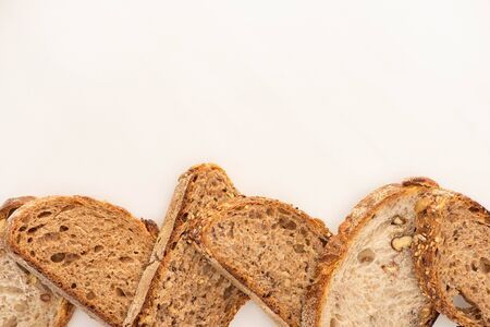 top view of whole grain bread slices on white background with copy space