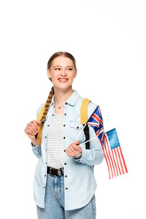 happy girl with braid and backpack holding flags of america and united kingdom isolated on white Banque d'images