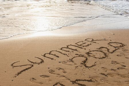 beach with summer 2020 lettering on sand near sea