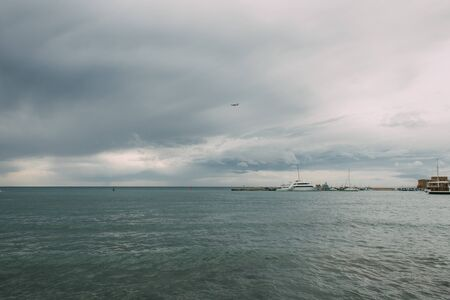 ships in mediterranean sea against sky with clouds